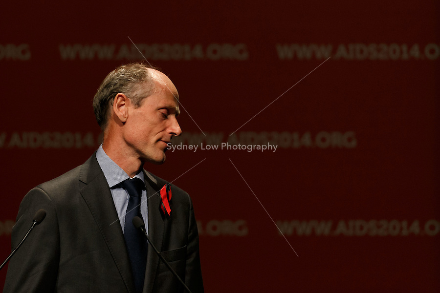Lambert Grijns, the Dutch Ambassador for Sexual and Reproductive Health and Rights & HIV/AIDS pays tribute to MH17 victims at the opening session of the 20th International AIDS Conference (AIDS 2014) at The Melbourne Convention and Exhibition Centre.<br /> For licensing of this image please go to http://demotix.com