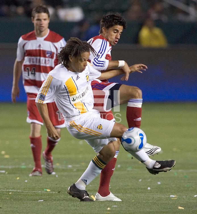 LA Galaxy MID Cobi Jones battles FC Dallas Marcelo Saragosa for a ball during a MLS match. FC Dallas beat LA Galaxy 2-1 at the Home Depot Center in Carson, California, Thursday April 12, 2007.