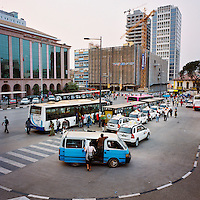 Buses, taxis and collective taxis (condongueiros) pick up passengers in Freedom Square in Maianga.