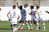 RICHMOND, VA - SEPTEMBER 30: Dre Fortune #8 of North Carolina FC celebrates his penalty kick goal with teammates Marios Lomis #9, Graham Smith #16, and Ben Speas #17 during a game between North Carolina FC and New York Red Bulls II at City Stadium on September 30, 2020 in Richmond, Virginia.