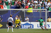 Gerardo Torrado (6) of Mexico (MEX) scores on a penalty kick in the 57th minute. Mexico (MEX) defeated the United States (USA) 5-0 during the finals of the CONCACAF Gold Cup at Giants Stadium in East Rutherford, NJ, on July 26, 2009.