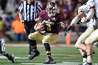 Texas State quarterback Tyler Jones (2) looks for room to run during second half of an NCAA Football game, Saturday, October 04, 2014 in San Marcos, Tex. Texas State defeated Idaho 35-30. (Mo Khursheed/TFV Media via AP Images)