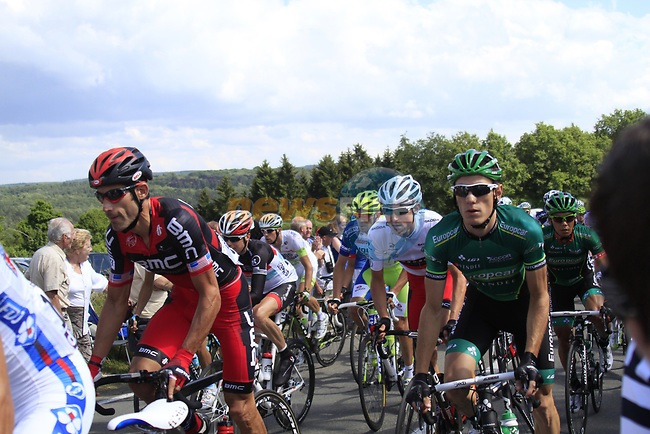 The peloton including George Hincapie (USA) BMC Racing Team and Pierre Rolland (FRA) Europcar Team climbs the Cote De Barvaux during Stage 1 of the 99th edition of the Tour de France, running 198km from Liege to Seraing, Belgium. 1st July 2012.<br /> (Photo by Eoin Clarke/NEWSFILE)