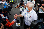 Champion #9 Scott Dixon, Chip Ganassi Racing Honda gets congratulated by Roger Penske