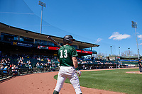 Great Lakes Loons James Outman (13) on deck during a Midwest League game against the Wisconsin Timber Rattlers at Dow Diamond on May 4, 2019 in Midland, Michigan. Great Lakes defeated Wisconsin 5-1. (Zachary Lucy/Four Seam Images)