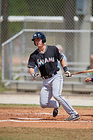 Miami Marlins first baseman Branden Berry (38) follows through on a swing during a minor league Spring Training game against the New York Mets on March 26, 2017 at the Roger Dean Stadium Complex in Jupiter, Florida.  (Mike Janes/Four Seam Images)
