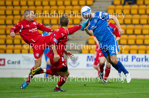St Johnstone v Morton..24.08.10  CIS Cup Round 2.Sam Parkin heads the ball off the toes of Michael Tidser.Picture by Graeme Hart..Copyright Perthshire Picture Agency.Tel: 01738 623350  Mobile: 07990 594431