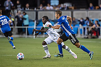 SAN JOSE, CA - MAY 15: Luciano Abecasis #2 of the San Jose Earthquakes challenges Yimmi Chara #23 of the Portland Timbers during a game between San Jose Earthquakes and Portland Timbers at PayPal Park on May 15, 2021 in San Jose, California.