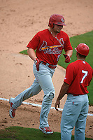 Palm Beach Cardinals manager Oliver Marmol (7) congratulates Luke Voit (25) rounding third on a home run during the first game of a doubleheader against the Dunedin Blue Jays on August 2, 2015 at Florida Auto Exchange Stadium in Dunedin, Florida.  Palm Beach defeated Dunedin 4-1.  (Mike Janes/Four Seam Images)