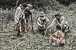 A group of hunters discussing their route to the best hunting grounds