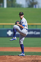 Surprise Saguaros starting pitcher Zach Lovvorn (34), of the Kansas City Royals organization, delivers a pitch to the plate during a game against the Mesa Solar Sox on October 20, 2017 at Sloan Park in Mesa, Arizona. The Solar Sox walked-off the Saguaros 7-6.  (Zachary Lucy/Four Seam Images)