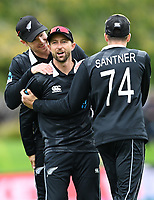 20th March 2021; Dunedin, New Zealand;  Mitchell Santner and Jimmy Neesham celebrate with Devon Conway who took a catch to dismiss Soumya Sarkar during the New Zealand Black Caps v Bangladesh International one day cricket match. University Oval, Dunedin.
