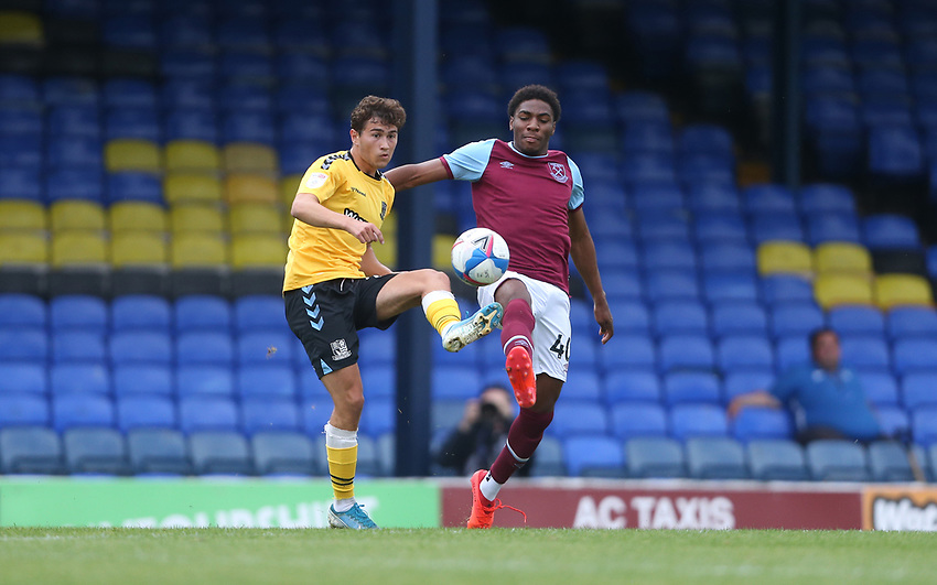 Southend United's Lewis Gard and West Ham United's Oladapo Afolayan<br /> <br /> Photographer Rob Newell/CameraSport<br /> <br /> EFL Trophy Southern Section Group A - Southend United v West Ham United U21 - Tuesday 8th September 2020 - Roots Hall - Southend-on-Sea<br />  <br /> World Copyright © 2020 CameraSport. All rights reserved. 43 Linden Ave. Countesthorpe. Leicester. England. LE8 5PG - Tel: +44 (0) 116 277 4147 - admin@camerasport.com - www.camerasport.com