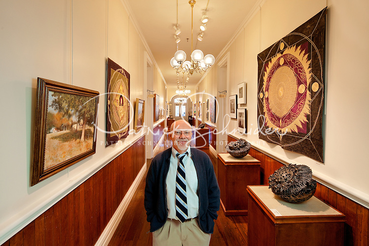 Photographic portrait of Lin Barnhardt, the Visual Arts Director for the Cabarrus Arts Council, an organization dedicated to providing a wide variety of cultural arts programs that celebrate the rich diversity of our county and our world. The arts council programs and operates the Davis Theatre and The Galleries, conducts one of North Carolina's largest art-in-education programs for both the Cabarrus County and Kannapolis City school systems, supports arts organizations and artists through grants and workshops, and serves as a catalyst and consultant for public and corporate art. Photo is part of a photographic series of images featuring Concord, NC, by Charlotte-based photographer Patrick Schneider..