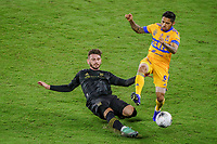 22nd December 2020, Orlando, Florida, USA;  LAFC Tristan Blackmon slides the ball away from Tigres Javier Aquino during the Concacaf Championship between LAFC and Tigres UANL on December 22, 2020, at Exploria Stadium in Orlando, FL.