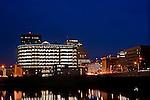 Downtown Dayton Ohio at night from North near Main Street Bridge. Showing Caresource building.