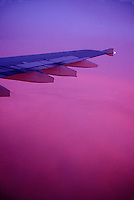 Aircraft wing and colorful sky<br />
