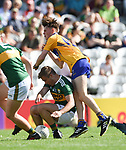 David Dineen of Kerry in action against Padraic O'Donoghue of Clare during their Munster Minor football final at Pairc Ui Chaoimh. Photograph by John Kelly.