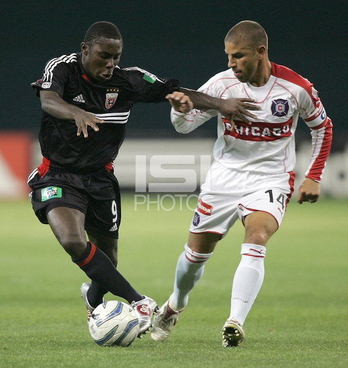 9 April 2005.  DC United's Freddy Adu (9) tries to take the ball past Chicago Fire midfielder Chris Armas (14)  at RFK Stadium in Washington, DC.