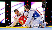 05 MAY 2012 - MANCHESTER, GBR - Aaron Cook (GBR) of Great Britain (on right, in blue) tries to console Ramin Azizov (AZE) of Azerbaijan after winning the men's -80kg final in the 2012 European Taekwondo Championships at Sportcity in Manchester, Great Britain when the referee penalised Azizov for stepping out of the field of play in the final second of the last round to give Cook the title (PHOTO (C) 2012 NIGEL FARROW)