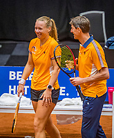 Den Bosch, The Netherlands, April 15, 2021,    Maaspoort, Billy Jean King Cup  Netherlands -  China : practice, Kiki Bertens (NED) with captain Paul Haarhuis (NED)<br /> Photo: Tennisimages/Henk Koster