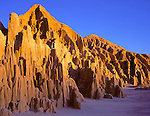 Cathedral Gorge State Park, NV  <br /> Evening sun on the eroded pillar-like patterns in the bentonite clay cliffs at Cathedral Gorge