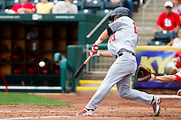 Mike Trout (23) of the Arkansas Travelers makes contact with a pitch during a game against the Springfield Cardinals on May 10, 2011 at Hammons Field in Springfield, Missouri.  Photo By David Welker/Four Seam Images.