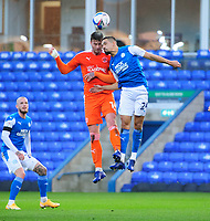 Blackpool's Gary Madine vies for possession with Peterborough United's Niall Mason<br /> <br /> Photographer Chris Vaughan/CameraSport<br /> <br /> The EFL Sky Bet League One - Peterborough United v Blackpool - Saturday 21st November 2020 - London Road Stadium - Peterborough<br /> <br /> World Copyright © 2020 CameraSport. All rights reserved. 43 Linden Ave. Countesthorpe. Leicester. England. LE8 5PG - Tel: +44 (0) 116 277 4147 - admin@camerasport.com - www.camerasport.com