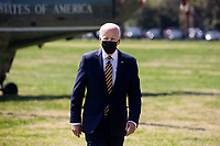 US President Joe Biden walks over to deliver brief remarks on infrastructure to members of the news media after arriving on the Ellipse by Marine One en route to the White House, in Washington, DC, USA, 05 April 2021. Biden returns to the White House following a trip to Camp David.<br /> CAP/MPI/RS<br /> ©RS/MPI/Capital Pictures