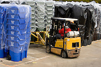A worker prepares to pick up a load of plastic garbage cans with a forklift at SSI Schaefer plastic manufacturing in Charlotte, NC.