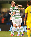 Celtic's Berget celebrates with Leigh Griffiths (28) after he scores their second goal.