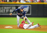 Jun. 29, 2011; Phoenix, AZ, USA; Arizona Diamondbacks base runner Ryan Roberts steals second base ahead of the tag from Cleveland Indians shortstop Asdrubal Cabrera in the second inning at Chase Field. Mandatory Credit: Mark J. Rebilas-