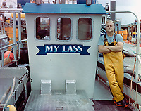 """BNPS.co.uk (01202) 558833. <br /> Pic: TomLambourn/BNPS<br /> <br /> Pictured: Tom Lambourn on his fishing boat """"My Lass"""". <br /> <br /> A fisherman has told of his 'one in two million' catch of a bright blue lobster.<br /> <br /> Tom Lambourn was stunned when he opened his lobster pot to find the vivid crustacean inside."""