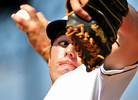 15 July 2010: Vermont Lake Monsters' starting pitcher Chris McKenzie warms up prior to a game against the Aberdeen IronBirds at Centennial Field in Burlington, Vermont. The Lake Monsters rallied in the bottom of the 9th inning to defeat the IronBirds 7-6 notching their league leading 20th win of the 2010 NY Penn League season. Mandatory Credit: Ed Wolfstein Photo