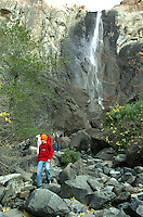 A boy walks on the rocks below Bridalveil Falls in Yosemite National Park in California November 22, 2008. (Photo Copyright Alan Greth)