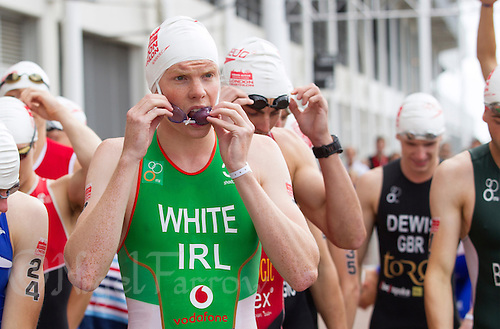 28 JUL 2013 - LONDON, GBR - Russell White (IRL) of Ireland waits for the start of the Elite Men's race during the 2013 Virgin Active London Triathlon at Excel, Royal Victoria Dock in London, Great Britain (PHOTO COPYRIGHT © 2013 NIGEL FARROW, ALL RIGHTS RESERVED)