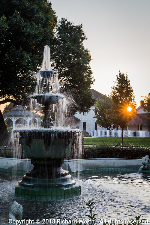 The flowing water fountain at Meek Park, next to the Meek Mansion, at sunset.  Hayward, California.