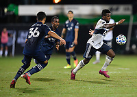 LAKE BUENA VISTA, FL - JULY 26: Cristian Dájome of Vancouver Whitecaps FC dribbles away from pressure during a game between Vancouver Whitecaps and Sporting Kansas City at ESPN Wide World of Sports on July 26, 2020 in Lake Buena Vista, Florida.