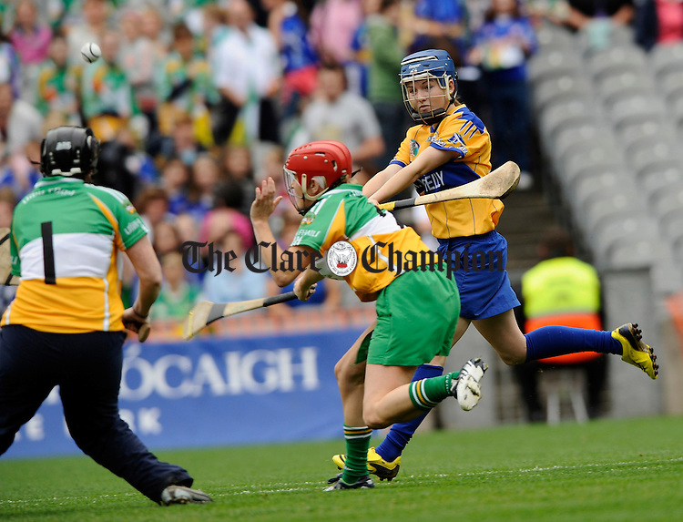 Clare's Carina Roseingrave goals depite the efforts of Offaly's Aoife Kennedy and goalie Audrey Kennedy during the All-Ireland junior camogie final at Croke Park. Photograph by John Kelly.