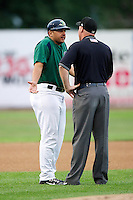 Beloit Snappers manager Nelson Prada #26 argues a call with umpire James Rackley during a game against the Clinton LumberKings at Pohlman Field on June 29, 2012 in Beloit, Wisconsin.  Clinton defeated Beloit 6-3.  (Mike Janes/Four Seam Images)