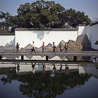 Tourists walk through a modern Chinese garden as they visit Suzhou Museum in Suzhou, Jiangsu province, 2012. (Mamiya 6, 75mm f3.5, Kodak Ektar 100 film)