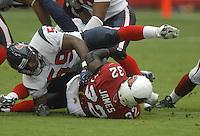 Aug 18, 2007; Glendale, AZ, USA; Arizona Cardinals running back Edgerrin James (32) is tackled by Houston Texans linebacker DeMeco Ryans (59) at University of Phoenix Stadium. Mandatory Credit: Mark J. Rebilas-US PRESSWIRE Copyright © 2007 Mark J. Rebilas