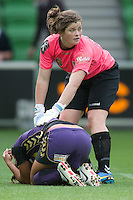 MELBOURNE, AUSTRALIA - DECEMBER 18: Brianna DAVEY of the Victory consoles an injured Glory player during the round 7 W-League match between the Melbourne Victory and the Perth Glory at AAMI Park on December 18, 2010 in Melbourne, Australia. (Photo Sydney Low / asteriskimages.com)