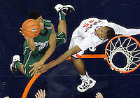 CHARLOTTESVILLE, VA- NOVEMBER 26:  Keifer Sykes #24 of the Green Bay Phoenix shoots in front of Akil Mitchell #25 of the Virginia Cavaliers during the game on November 26, 2011 at the John Paul Jones Arena in Charlottesville, Virginia. Virginia defeated Green Bay 68-42. (Photo by Andrew Shurtleff/Getty Images) *** Local Caption *** Akil Mitchell;Keifer Sykes