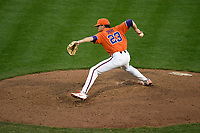 Relief pitcher Carson Spiers (23) of the Clemson Tigers delivers a pitch in a game against the William and Mary Tribe on February 16, 2018, at Doug Kingsmore Stadium in Clemson, South Carolina. Clemson won, 5-4 in 10 innings. (Tom Priddy/Four Seam Images)