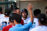 Inland Empire 66ers designated hitter Jared Walsh (21) is congratulated by teammates after scoring his third run of the afternoon during a California League game against the Lancaster JetHawks at San Manuel Stadium on May 20, 2018 in San Bernardino, California. Inland Empire defeated Lancaster 12-2. (Zachary Lucy/Four Seam Images)