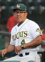 Manager Luis Salazar (4) of the Lynchburg Hillcats, Carolina League affiliate of the Atlanta Braves, prior to a game against the Wilmington Blue Rocks on June 15, 2011, at City Stadium in Lynchburg, Va. Salazar was struck in the left eye with a foul ball in Spring Training and has received an artificial eye. Photo by Tom Priddy / Four Seam Images
