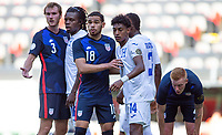 GUADALAJARA, MEXICO - MARCH 28: Henry Kessler #3, Hassani Dotson #18 and  Justen Glad #4 of the United States await a corner kick in the box during a game between Honduras and USMNT U-23 at Estadio Jalisco on March 28, 2021 in Guadalajara, Mexico.