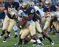 Pittsburgh linebacker Dan Mason (40) sacks Navy quarterback Ricky Dobbs. The Pittsburgh Panthers defeated the Navy Midshipmen 27-14 at Heinz Field, Pittsburgh, PA.