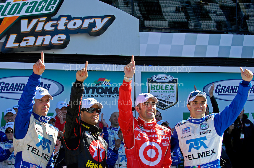 The winners in Victory Lane (L to R): Scott Pruett, Juan Pablo Montoya, Dario Franchitti and Memo Rojas.
